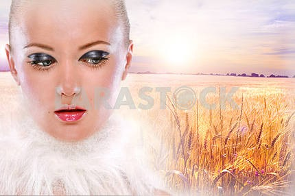 Portrait beautiful girl against the backdrop golden wheat ready