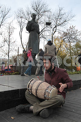 A student is playing a drum