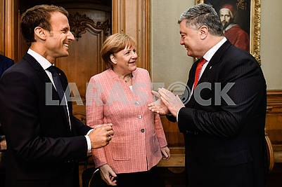 Emmanuelle Macron, Angela Merkel and Petro Poroshenko