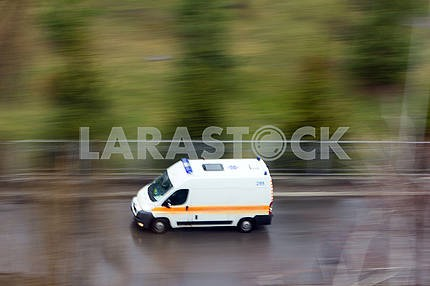 Ambulance in the city on a blurred background .
