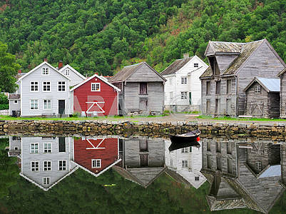 Wooden houses and reflection