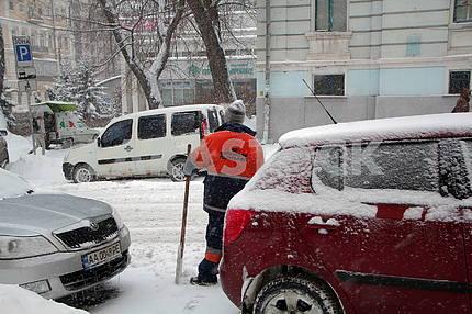 Parker cleans the snow