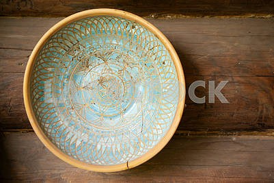 Typical ethnic porcelain bowl with floral and ornamentic pattern. Traditional styled souvenir from Belarus.