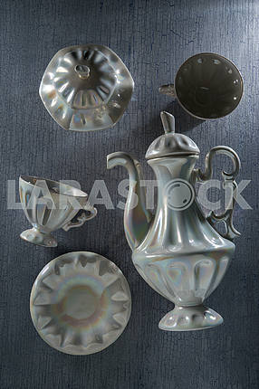 Coffee set - teapot with cups on the table