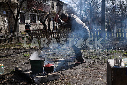 A man cooks food at the stake in Balakley
