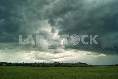 Clouds and rain over fields and forests