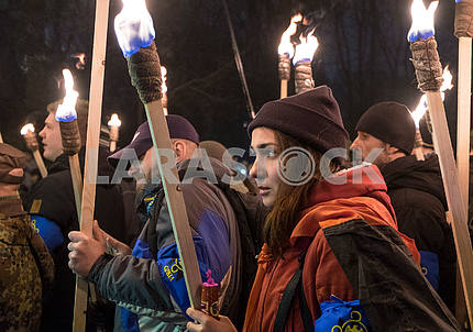 Girl holds the torch