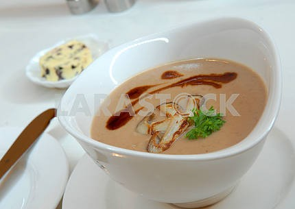 Soup from chestnuts in a white cup