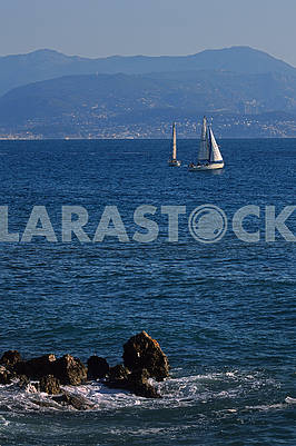 Two of sailing boats floating on the sea