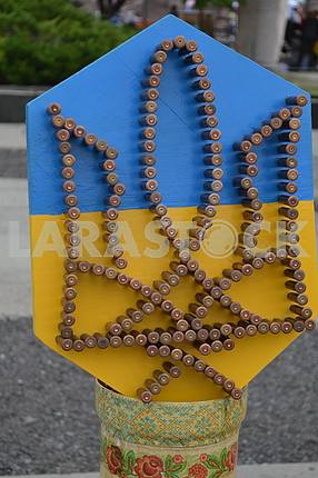 Emblem of Ukraine made of shells on the bottom of Kramatorsk