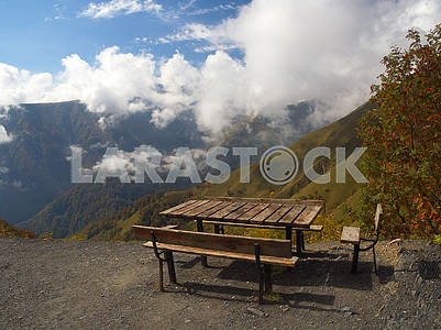 Table and benches over the slope