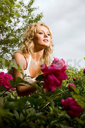 Lovely young woman relaxing on a garden