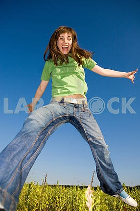 Happy jumping young woman