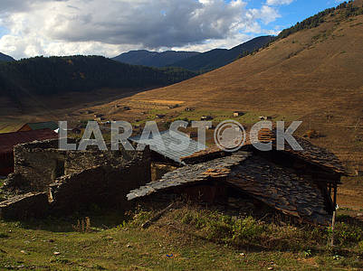 Ruined house and stone roofs