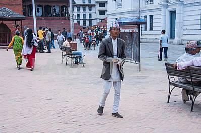 The man in national dress walking down the street.