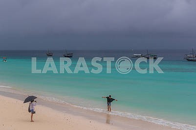 Holidaymakers and fishing boats