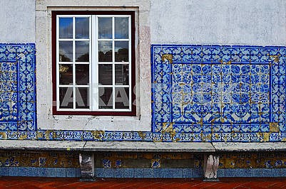 The wall is lined with tiled azuljozo on the terrace of the Monastery of Sao Vicente de Fora