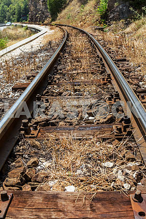 ailroad tracks on the old worn wooden sleepers require urgent re