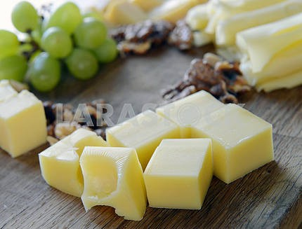 Set cheese on a wooden board