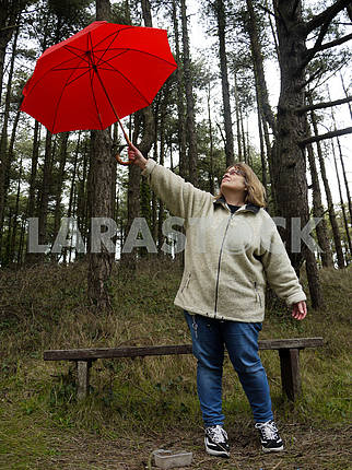 Woman Holding Up a Red Umbrella