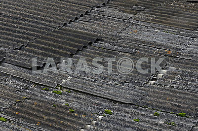 The destroyed asbestos roof in the dark weather