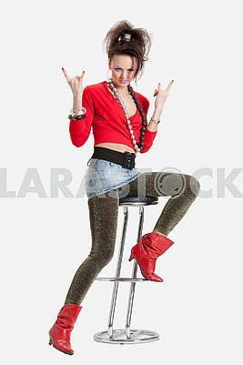 Picture of a young playful lady on a high chair