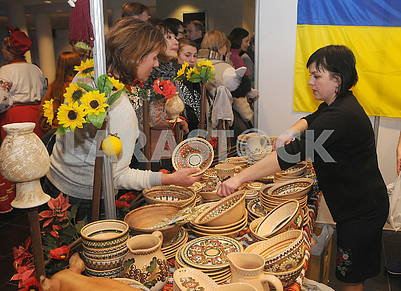 A woman selling a pottery