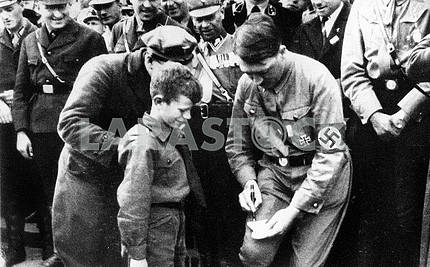 Adulf Hitler gives autograph