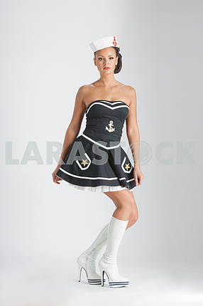 Beauty pinup girl in a sailor suit