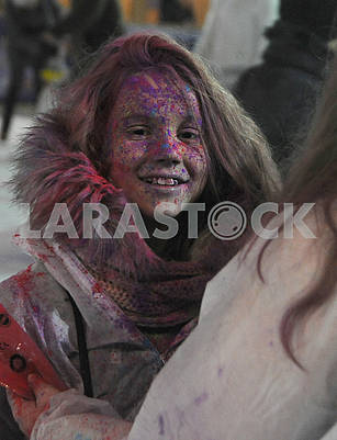 Festival participant with face painted paint