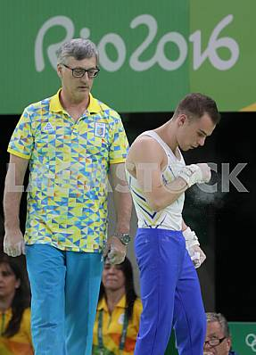 Oleg Oleg Verniaiev performs an exercise on the rings