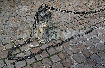 Stone pillar with metal chain