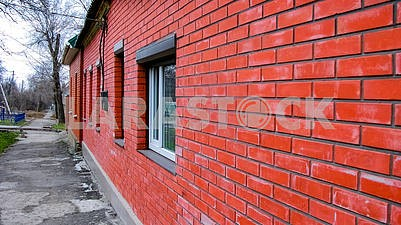 Wall made of the red brick with windows  of modern private dwell