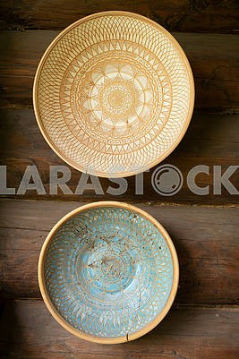 Empty clay bowls on a wooden background. Top view. Authentic bowls of Belarus