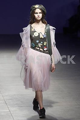 The model demonstrates outfit by Ukrainian designer Sofia Rousinovich
