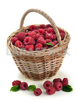 Fresh sweet raspberries in a wicker basket