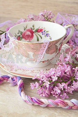 Lilac flowers with vintage cup, violet and purple colors