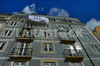 Building facade is covered with azulejos