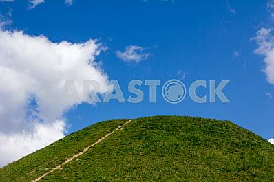 Paths and hills against the blue sky