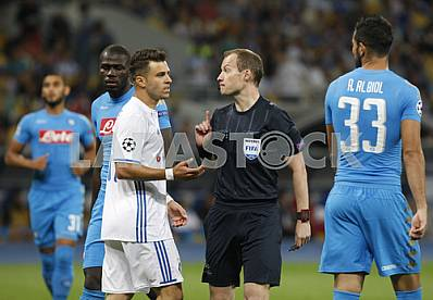 The referee (2r) and players during a game Dynamo (Kyiv) - Napoli (Naples)