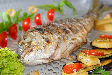 Fried fish dorado with vegetables
