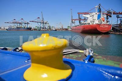 Yellow bollard and ship